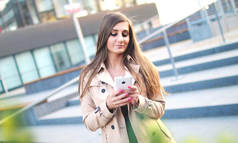 Enterprise Apps: Girl holding smartphone